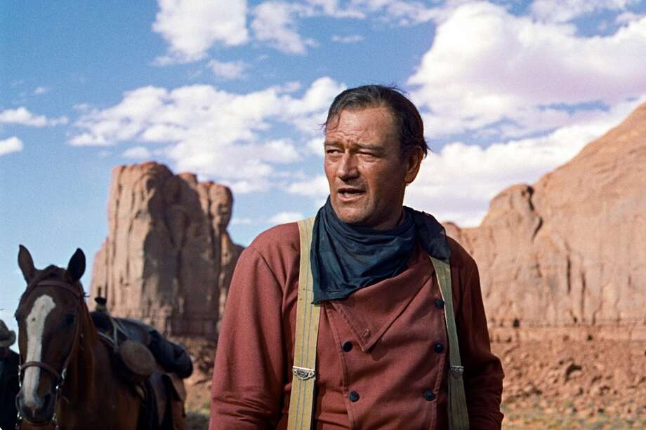 John Wayne -- another immediately identifiable, unforgettable screen voice. Photo: Warner Bros. 1956, AP
