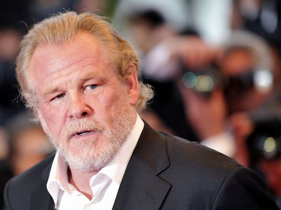 Nick Nolte -- like sandpaper on broken glass, with a bucket of whiskey poured on top, but unmistakable. Photo: ANNE-CHRISTINE POUJOULAT, AFP/Getty Images / AFP