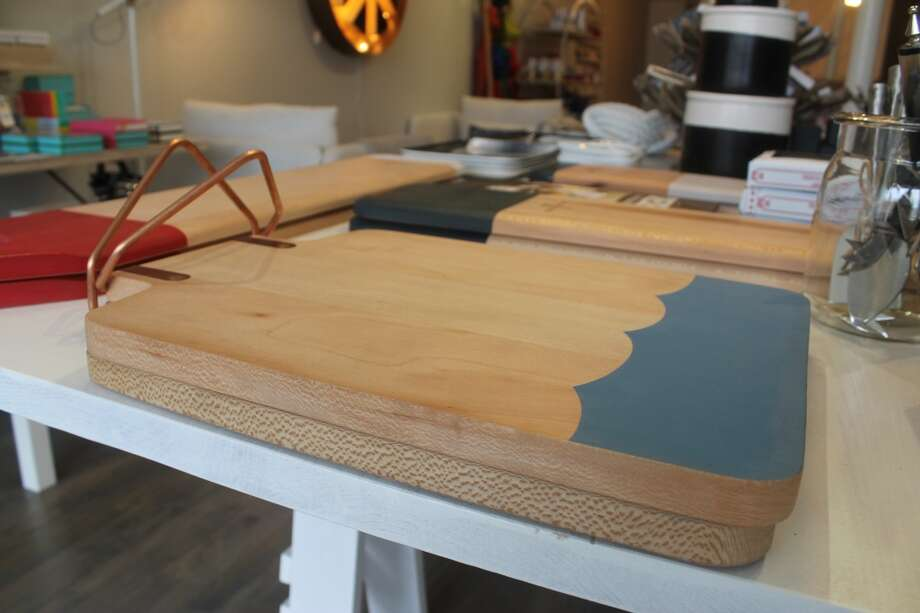 Put the boring cutting board away! These serving boards lend a modern edge to nautical design (love the architectural handle!)