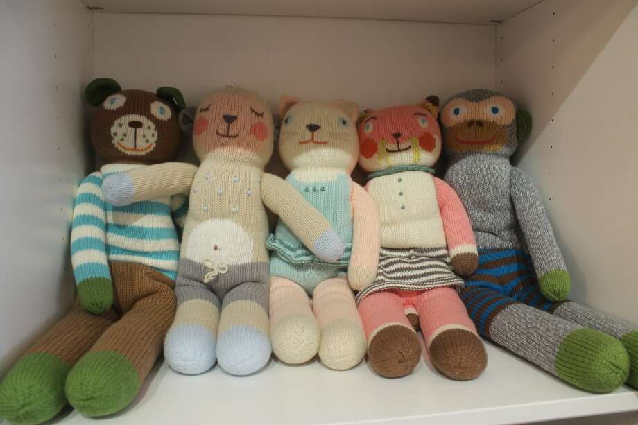 A menagerie of hand-stitched stuffed dolls awaits tiny, loving hands.