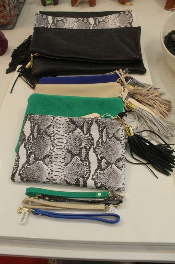 Butter soft leather clutches from up-and-coming handbag designer, Blair Ritchey, comes in two sizes boasts a fun tassel.  The smaller size has a detachable wrist strap - tuck it in your tote bag during the day...at night, clip it on and it becomes a chic evening bag.