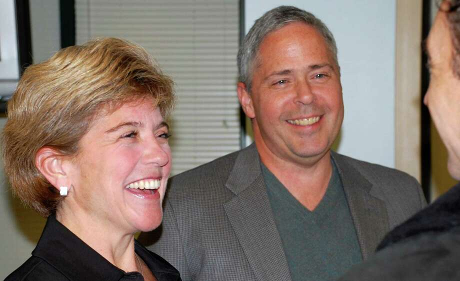 Departing Board of Education members Jennifer Tooker and Michael McGovern at their last meeting as board members Monday night. Photo: Jarret Liotta / Westport News contributed
