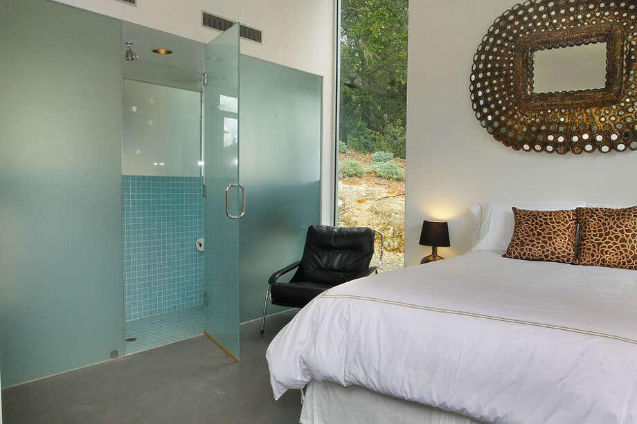 2nd bed and bath entrance. Photos via Sotheby's/Ginger Martin