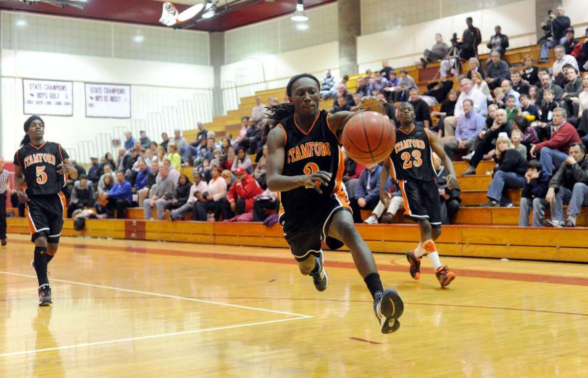 Stamford's Uriah Watkin breaks free as Greenwich High hosts Stamford High in a boys basketball game Friday night, January 29, 2010. Greenwich won the game 58-37.