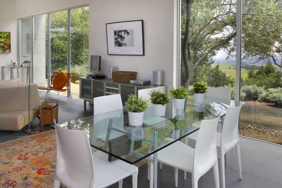Another view of guest dining area. Photos via Sotheby's/Ginger Martin