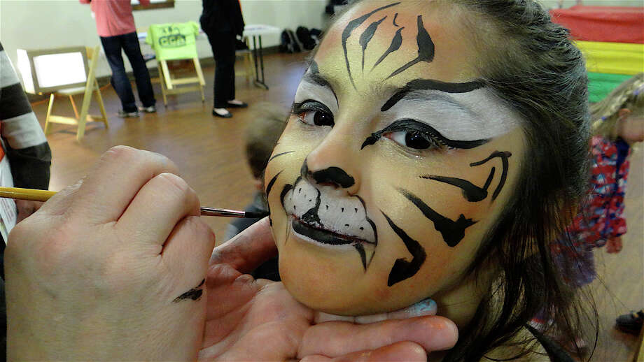 Daniela Delgado, 6, of Stamford, shows off her newly painted face at the Westport Country Playhouse's Family Festivities Kick-off Party on Sunday. Photo: Mike Lauterborn / Westport News contributed