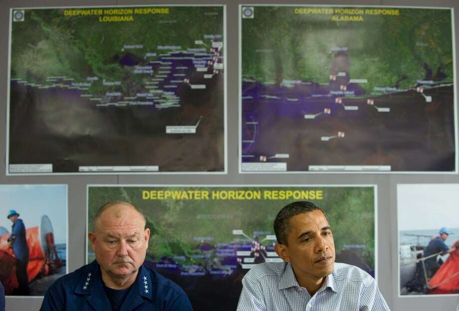 U.S. President Barack Obama speaks alongside US Coast Guard Admiral Thad Allen (left), who was in charge of the federal response to the oil spill, following a briefing with officials at the Tarmac Field House at Louis Armstrong New Orleans International Airport in New Orleans on June 4, 2010. Obama traveled to the Gulf Coast, his third trip to the region following the oil spill from BP's Deepwater Horizon well in the Gulf of Mexico. Photo: SAUL LOEB, AFP/Getty Images