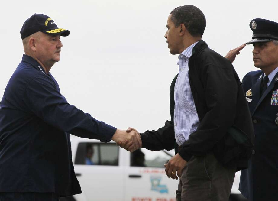 President Barack Obama is greeted by then-National Incident Commander for the Deepwater Horizon oil spill response Adm. Thad Allen as he arrives at Louis Armstrong International New Orleans Airport in Kenner, La., Friday, June 4, 2010. Photo: Charles Dharapak, AP