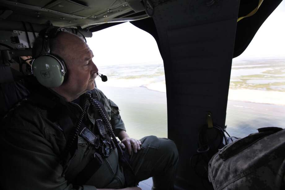 Ret. Coast Guard Adm. Thad Allen, then the national incident commander for the Depwater Horizon oil spill response,  looks out from his helicopter as he tours clean-up efforts along the Lousiana coast between Port Fourchon and Venice La., Thursday, May 27, 2010. Photo: Gerald Herbert, AP