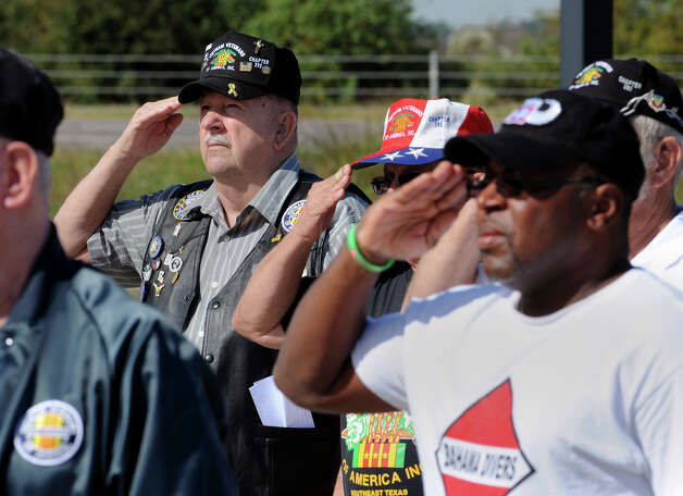 From left, Rodney Gobert, Floyd Riley and Don Smart salute for the American Anthem during a Veteran's Day ceremony at the Ben J. Rogers Regional Visitors Center on Monday.  Veterans and supporters attended a ceremony Monday at the Center to honor former American military personal and remember their sacrifices. Photo taken November 11, 2013 Guiseppe Barranco/@spotnewsshooter Photo: Guiseppe Barranco, Photo Editor