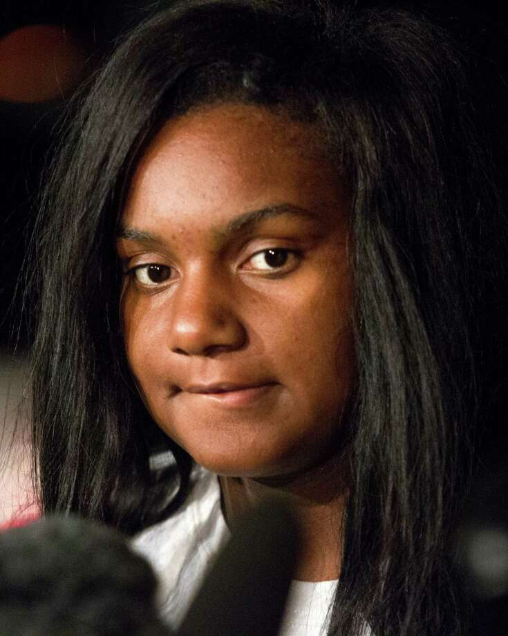 Brayiannia Young speaks with the media during a press conference outside Ben Taub hospital on Monday, Nov. 11, 2013, in Houston. Brayiannia was shot during a house party where two people were killed and 19 injured in the Cypress area on Saturday night.  Her brother, Willie Young, 21, was arrested and charged with deadly conduct  on Monday. A second suspect Randy Stewart, 18, was arrested and charged with aggravated assault.  She claims her brother could not have done the shooting. Photo: J. Patric Schneider, For The Chronicle / © 2013 Houston Chronicle