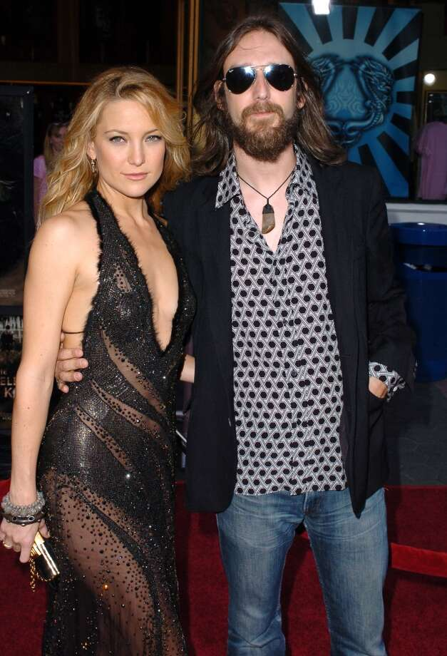 "Kate Hudson and Chris Robinson (seen here at the 2005 premier of Hudon's film ""The Skeleton Key"") broke up in 2006 after six years of marriage (and the birth of son Ryder) but have remained friends following the split. From the start the Hollywood Princess (Hudson is the Academy Award nominated daughter of Academy Award winner Goldie Hawn and step-daughter of Kurt Russell) and the Black Crows frontman were an odd couple but they seemed to make it work. Hawn even welcomed Robinson into the blended Hollywood clan by saying he shared ""a similar free spirit"" with the Hudson-Hawn-Russells. Robinson and Hudson have been seen laughing and chatting at several of Ryder's school events (amicable breakups are so much easier when kids' happiness is at stake) and Hudson even visited Robinson and his new wife upon the birth of their daughter. Photo: SGranitz, WireImage"