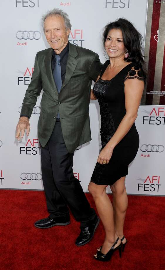 "Clint Eastwood and wife Dina Eastwood ( seen at the premiere of ""J. Edgar"" at Grauman's Chinese Theatre on November 3, 2011 in Hollywood) were married in 1996 and split in August of 2013. Even though this breakup is relatively new both Eastwood's admitted they had been living separately for some time. So far the ""Dirty Harry"" legend and ""Mrs. Eastwood & Company"" reality star are remaining friendly and civil for the sake of daughter Morgan. Photo: Gregg DeGuire, FilmMagic"