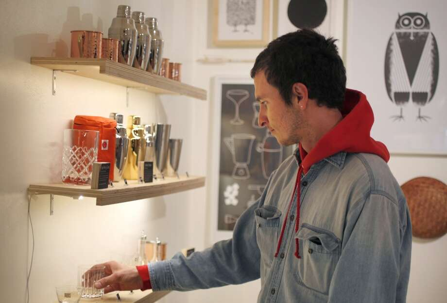 Daniel White checks out glassware for sale. Photo: Leah Millis, The Chronicle