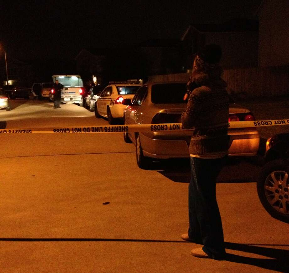 Parent waits on a child at the scene of a Cypress-area shooting. Photo: Anita Hassan, Houston Chronicle