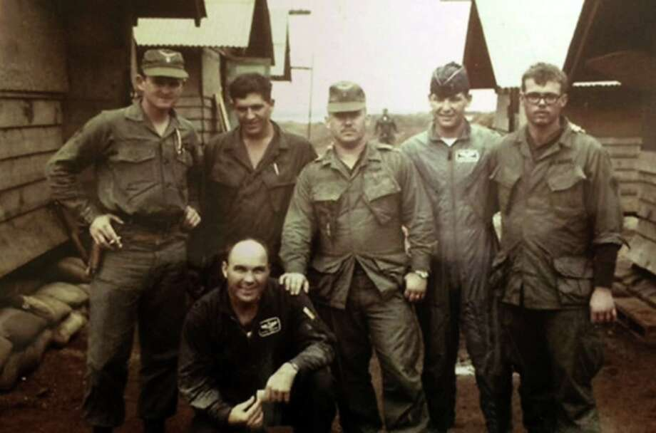 From left to right, Co-pilot, Chief Warrant Officer Charles L. Canfield, Spc. Arthur W. Gross, Maj. Glenn Nordin (kneeling), helicopter pilot, Warrant Officer James M.White, backseat pilot, 1st Lt. Bob Riddick and Spc. David W. Kinard. Photo: Courtesy