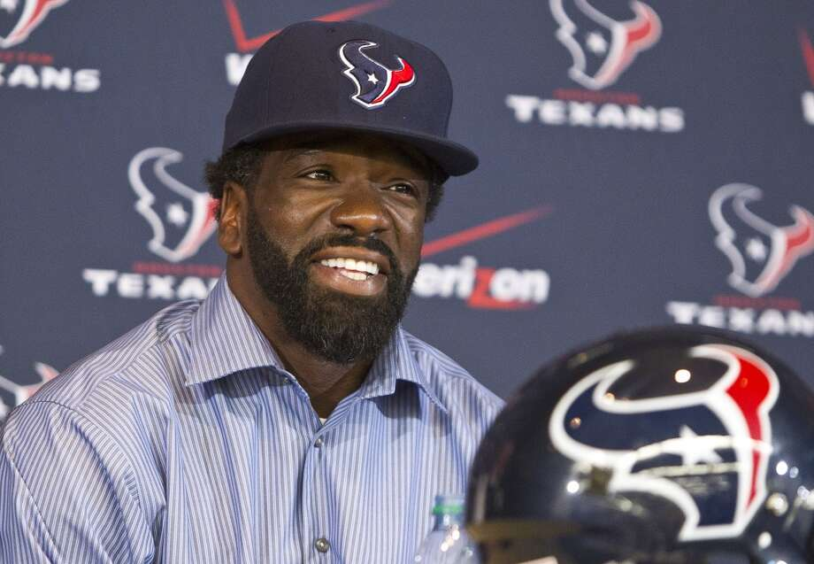 Ed Reed laughs while answering a question during his introductory news conference on March 22. Photo: Nick De La Torre, Houston Chronicle