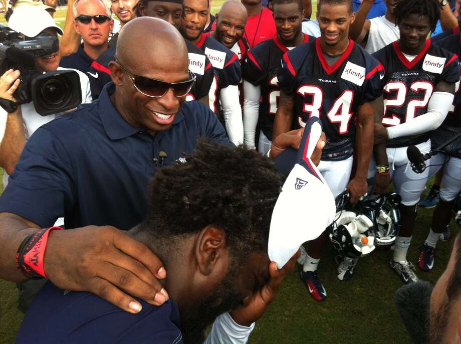 Ed Reed shares a laugh with Hall of Famer Deion Sanders during training camp. Photo: Brett Coomer, Houston Chronicle