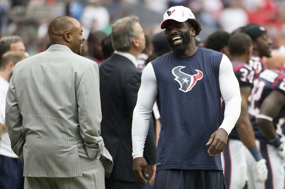 Ed Reed laughs with general manager Rick Smith before a preseason game on Aug. 25. Reed did not play in the preseason. Photo: Smiley N. Pool, Houston Chronicle