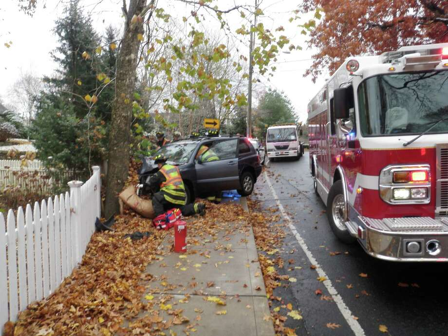 The driver was injured when an SUV struck a tree Tuesday on Bridge Street in Westport. Photo: Contributed Photo / Connecticut Post Contributed