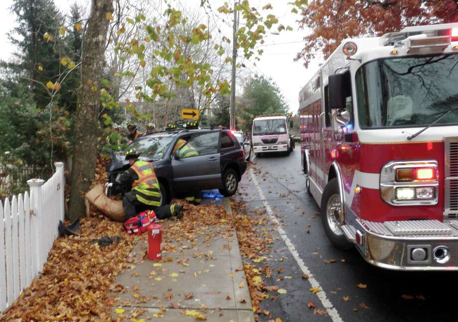 A Toyota Highlander SUV crashed into a tree on Bridge Street, injuring the driver Tuesday morning. Photo: Westport Fire Department / Westport News contributed