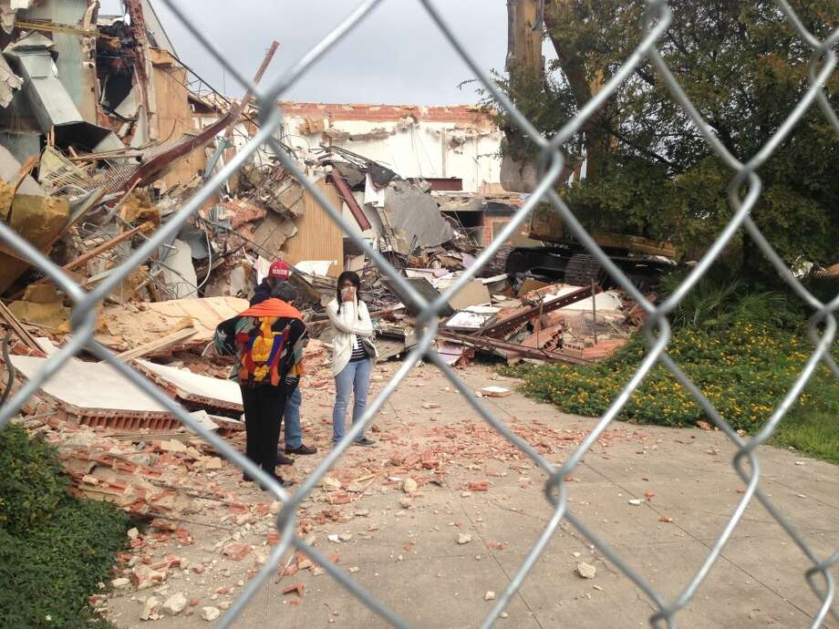 Preservationists find a way across to the demolition side of the fence. Photo: Benjamin Olivo/Express-News