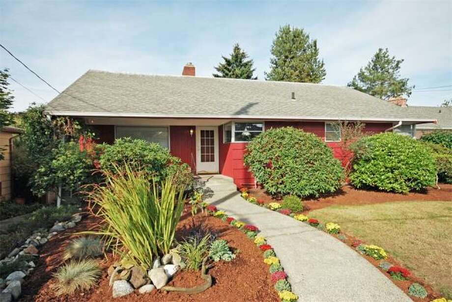 First comes 12727 Dayton Ave. N. The 2,500-square-foot house, built in 1952, has four bedrooms, 1.75 bathrooms, two fireplaces, a rec room, a bar, built-ins a front porch and a patio on a 7,650-square-foot lot. It's listed for $409,950. Photo: Deborah Arends,  RE/MAX Northwest Realtors