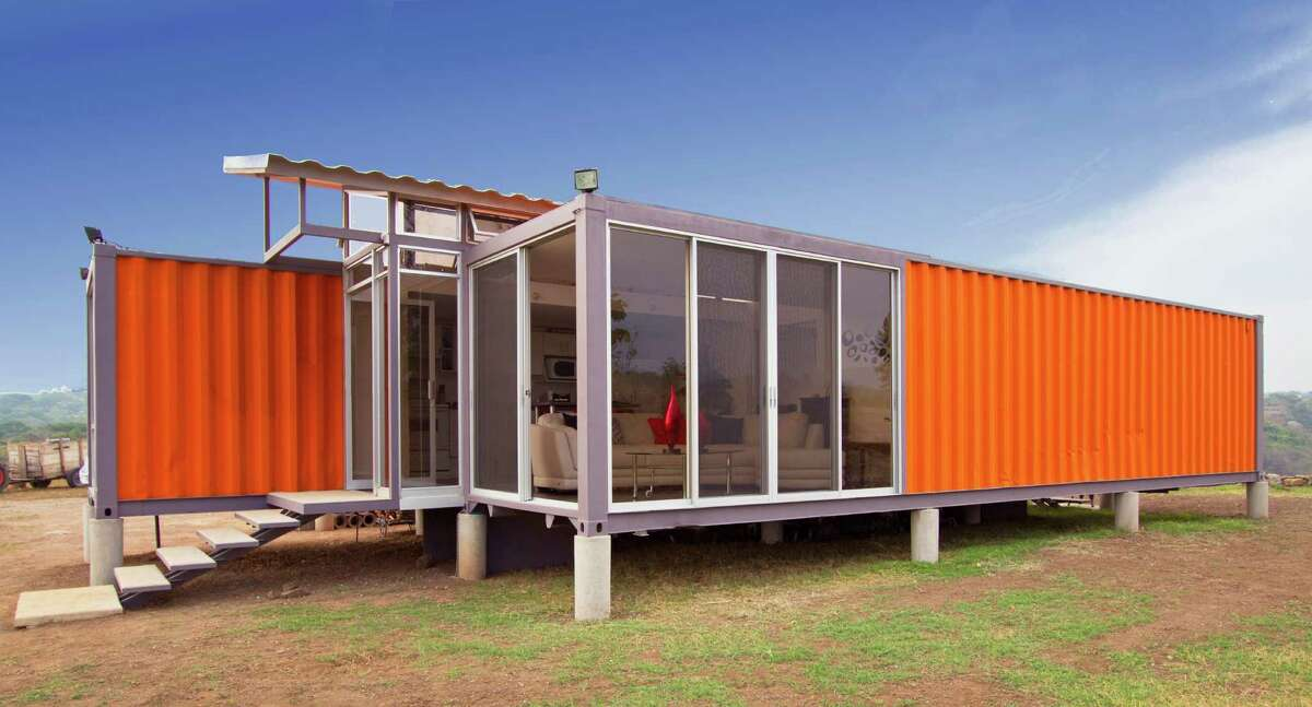 The U.S. Green Building Council's Piney Woods chapter has joined with the New Caney school district to build a demonstration house, crafted from used shipping containers. An example of a house made from a container is shown above.