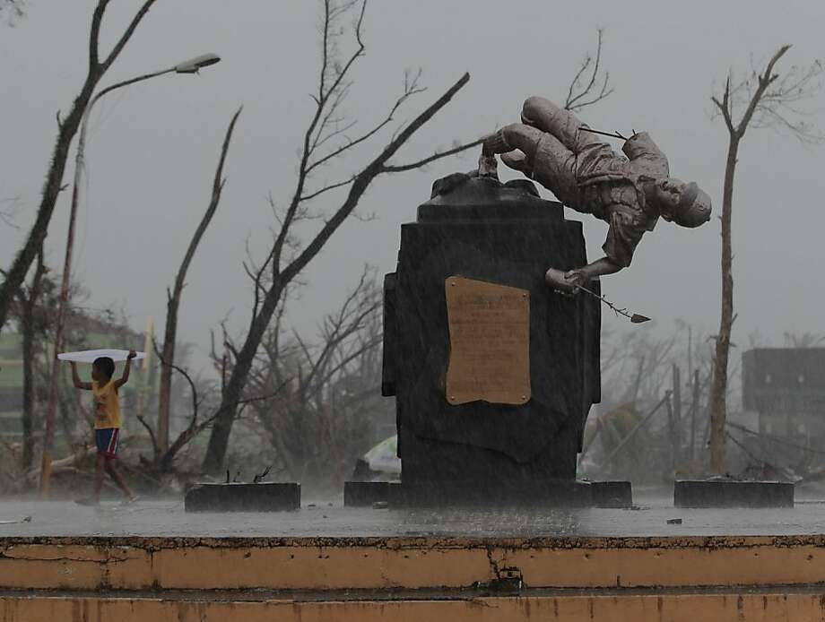 Toppled Tenderfoot: Among the casualties of Super Typhoon Haiyan was the Boy Scout statue in Tacloban, Leyte province. Photo: Aaron Favila, Associated Press