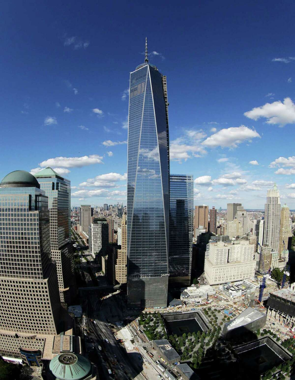 WORLD'S TALLEST BUILDINGS FILE - In this Thursday, Sept. 5, 2013, file photo taken with a fisheye lens, 1 World Trade Center, center, overlooks the wedge-shaped pavilion entrance of the National September 11 Museum, lower right, and the square outlines of the memorial waterfalls in New York. According to the nonprofit Council on Tall Buildings and Urban Habitat, 1 World Trade Center, once completed, will be the third tallest building in the world with a height of 1,776 feet.