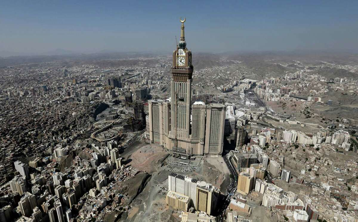 FILE - This Oct. 27, 2012 file aerial image made from a helicopter shows the Abraj Al-Bait Tower, also known as Makkah Royal Clock Tower Hotel, during the annual Hajj in the Saudi holy city of Mecca, Saudi Arabia. According to the nonprofit Council on Tall Buildings and Urban Habitat, the Abraj Al-Bait Tower is the second tallest completed building in the world with the height measured at 1,972 feet.