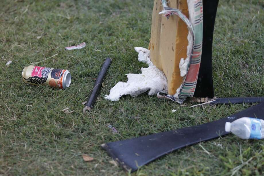 Debris remains scattered on the lawn of the Cypress home where two teens were killed and more than one dozen were injured when shots broke out at a party Saturday night. Photo: Johnny Hanson, Houston Chronicle