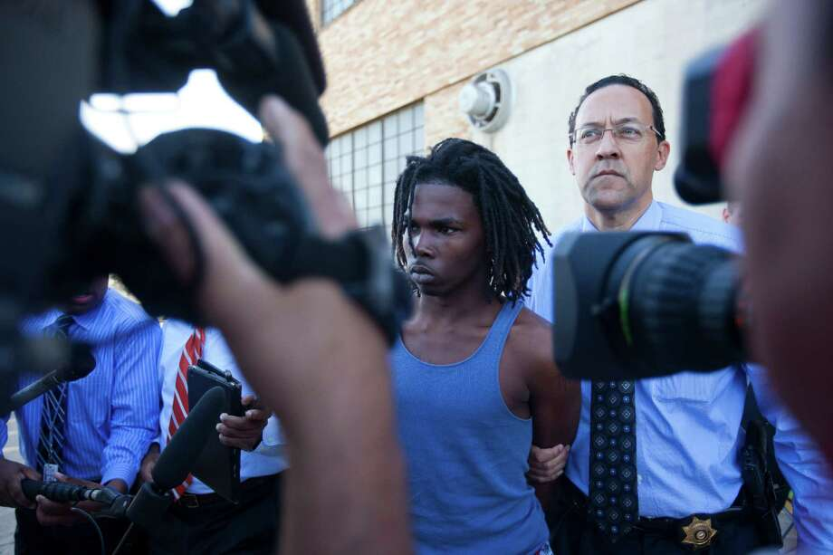 "Randy Stewart, 18, is transferred from the Harris County Sheriff Office Building to a patrol vehicle, Monday, Nov. 11, 2013, in Houston. When asked if he knew the victim he answered ""he was my brother"". Photo: Marie D. De Jesus, Houston Chronicle / © 2013 Houston Chronicle"