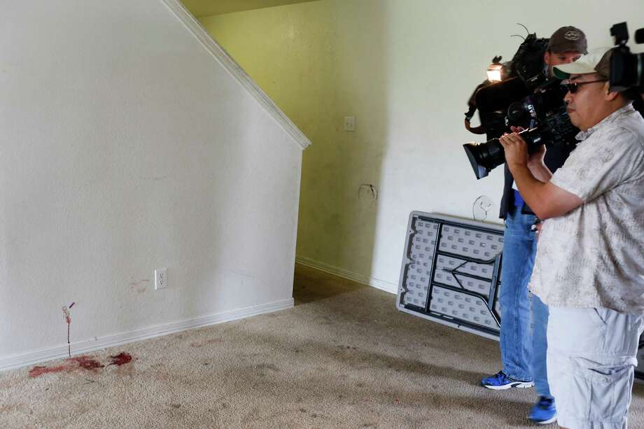 Blood stains the carpet and wall inside the home where shooting erupted, resulting in the deaths of two people and injuries to 20 others Saturday when gunfire erupted at a house party in the Cypress area. Photo: Eric Kayne / Eric Kayne