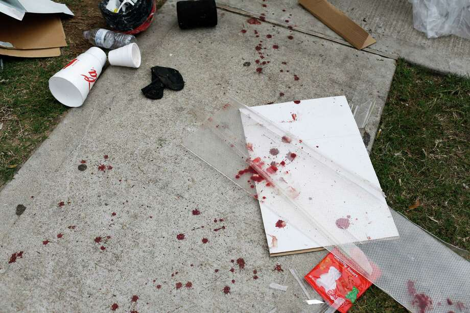 Blood is splattered near the front entrance of a home where two people were killed and at least 16 others wounded late Saturday when gunfire erupted at a house party in the Cypress area, authorities said. The shooting broke out about 11:15 p.m. in the 7300 block of Enchanted Creek Drive, near Fry and FM 529. Nov. 10, 2013 in Houston. Photo: Eric Kayne, For The Chronicle / Eric Kayne