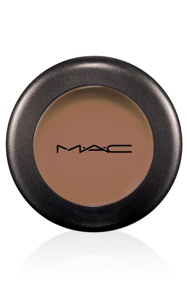 Soft Brown eyeshadow was swept around the entire eye with MAC's #217 brush. Photo: MAC