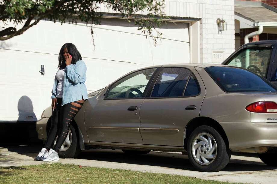 Mariah Boulden,18, stands outside her home where two people were killed and at least 16 others wounded late Saturday when gunfire erupted during her birthday party in the Cypress area, authorities said. The shooting broke out about 11:15 p.m. in the 7300 block of Enchanted Creek Drive, near Fry and FM 529. Nov. 10, 2013 in Houston. Photo: J. Patric Schneider, For The Chronicle / © 2013 Houston Chronicle