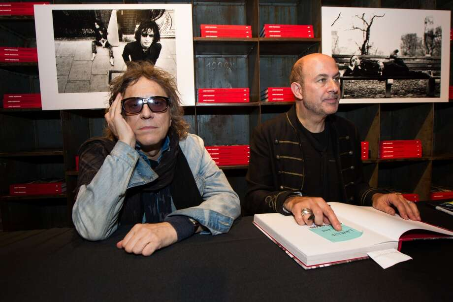 "Photographer Mick Rock (L) and fashion designer John Varvatos sign books at the launch of the book ""Rock In Fashion"" at John Varvatos on November 8, 2013 in San Francisco, California. Photo: Kimberly White, Getty Images For John Varvatos"