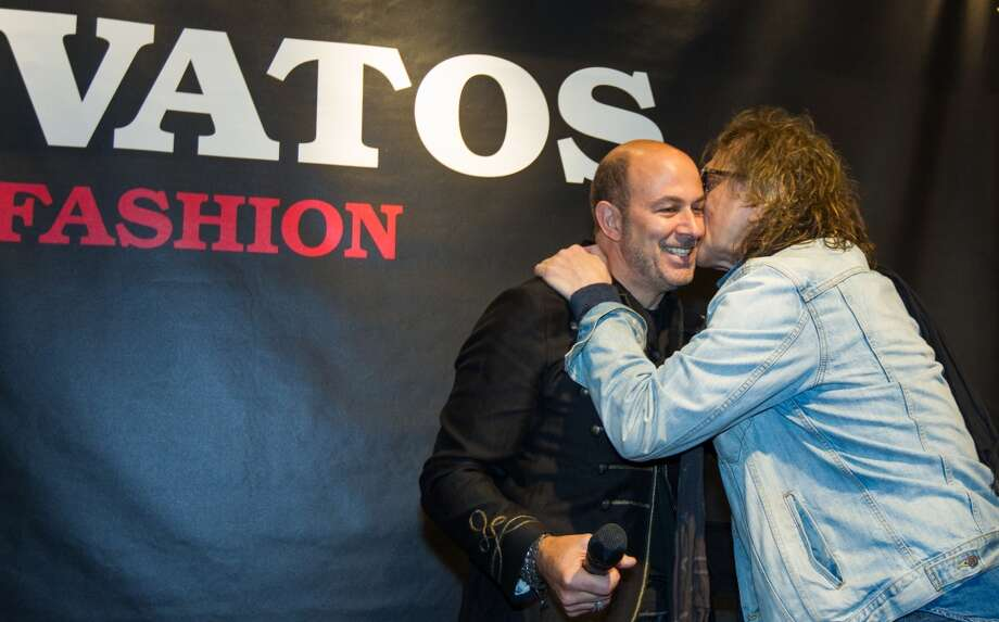 "Fashion designer John Varvatos (L) is kissed by photographer Mick Rock  at the launch of the book ""Rock In Fashion"" at John Varvatos on November 8, 2013 in San Francisco, California. Photo: Kimberly White, Getty Images For John Varvatos"