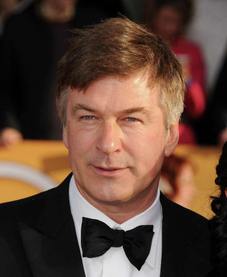 FILE - In this Jan. 27, 2013 file photo, Alec Baldwin arrives at the 19th Annual Screen Actors Guild Awards at the Shrine Auditorium in Los Angeles.  Baldwin is expected to testify Tuesday, Nov. 12, 2013, in Genevieve Sabourin's  (ZHAHN'-vee-ehv sah-boor-EHN') trial in New York City. Prosecutors say she bombarded the actor with messages professing her love and showed up uninvited at his New York and Hamptons homes in 2012. (Photo by Jordan Strauss/Invision/AP, File) ORG XMIT: CAET454 Photo: Jordan Strauss / Invision
