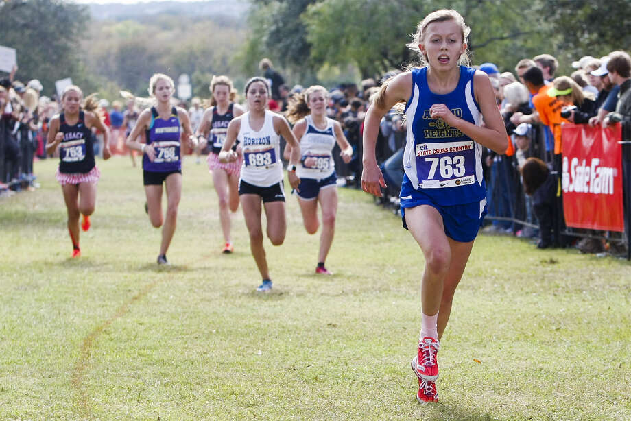 Alamo Heights' Abby Gray, right, approaches the finish line of the Class 4A girls 5,000-meter run during the UIL state cross-country meet Saturday at Old Settlers Park in Round Rock. Photo: Marvin Pfeiffer/ North Central News