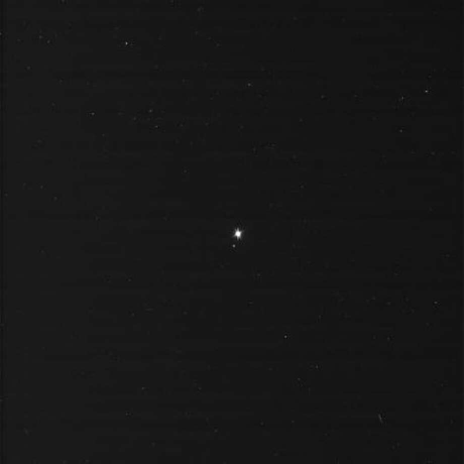 This image was taken on July 19, 2013 and received on Earth July 20, 2013. The camera was pointing toward EARTH at approximately 898,410,414 miles (1,445,851,410 kilometers) away, and the image was taken using the BL1 and CL2 filters. Photo: NASA