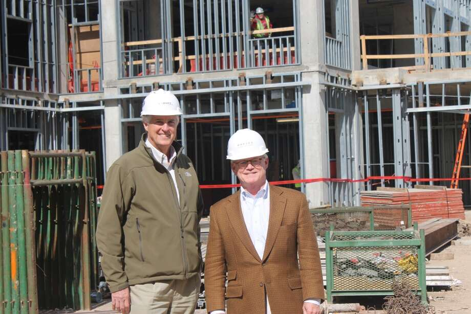 David Harvey, Jr., chairman and CEO of Harvey Builders, and Paul Chapman, chief development officer of Belmont Village Senior Living, at the topping out ceremony. Photo: Belmont Village Senior Living