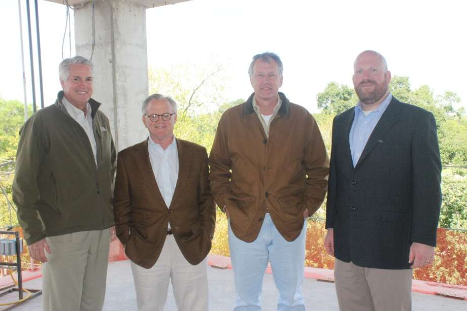 David Harvey, Jr., chairman and CEO, Harvey Builders; Paul Chapman, chief development officer, Belmont Village Senior Living; Stephen Brollier, vice president of development, Belmont Village Senior Living; and Steve Torno, project manager, Harvey Builders, on the fourth floor of Belmont Village's six-story mid-rise during the Friday, Nov. 8, 2013 topping out ceremony for the structure. Photo: Belmont Village Senior Living