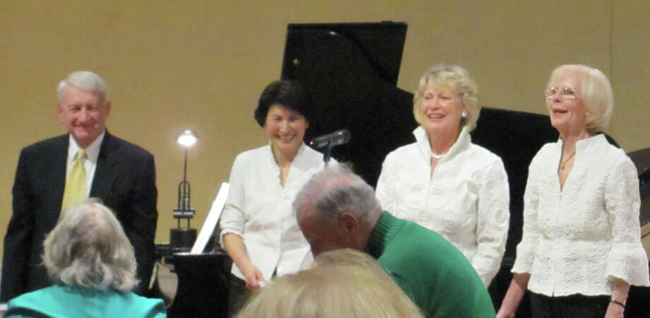 Several Duo Piano group pianists take a bow at a recent performance. From left, Darien residents John Thackeray and Yuki Yamaguchi, New Canaan resident Kathy Edwards and Wilton resident Karen Curtain. Photo: Contributed Photo, Contributed / Darien News