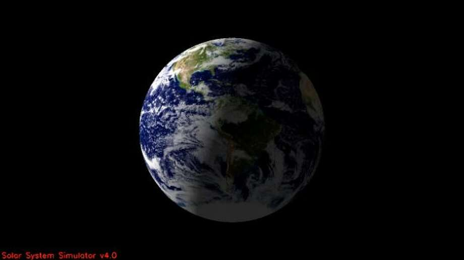 This is the Earth:  North America and part of the Atlantic Ocean are expected to be illuminated when NASA's Cassini spacecraft takes a snapshot of Earth on July 19, 2013. This view is a close-up simulation. Photo: NASA/JPL-Caltech