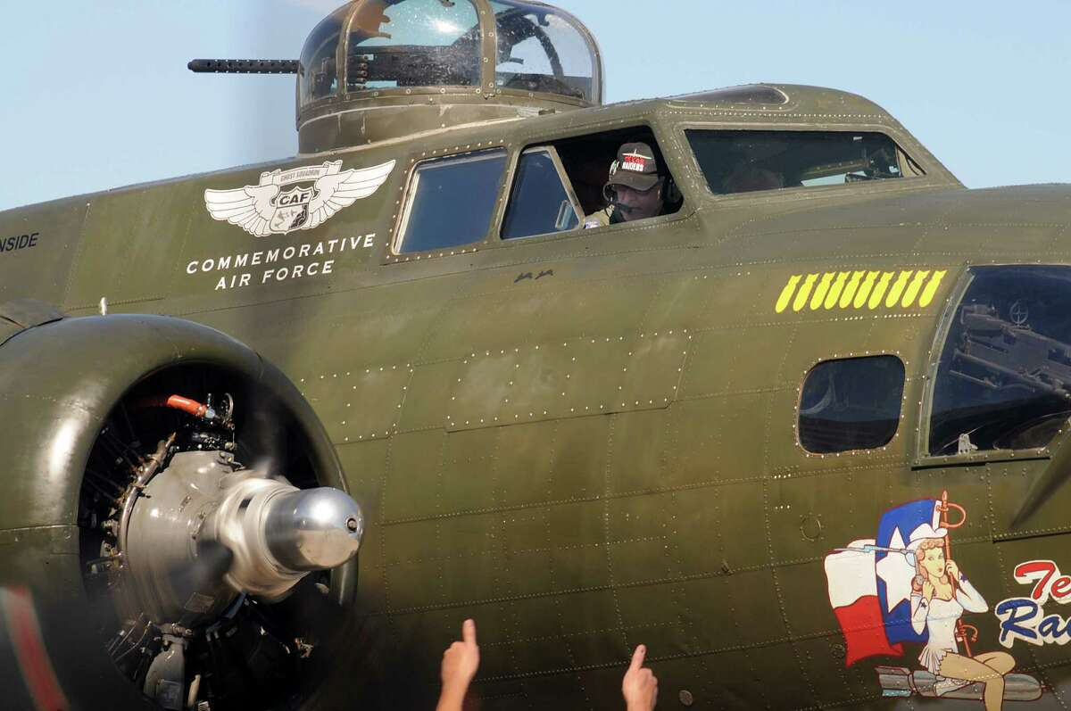 Co-pilot Ole Nygren receives the thumbs up during the engine start up of Texas Raiders, the B-17 bomber, at the Tomball Jet Center at Hooks Airport. Visitors toured and some flew on the plane owned by the Commemorative Air Force Gulf Coast Wing.
