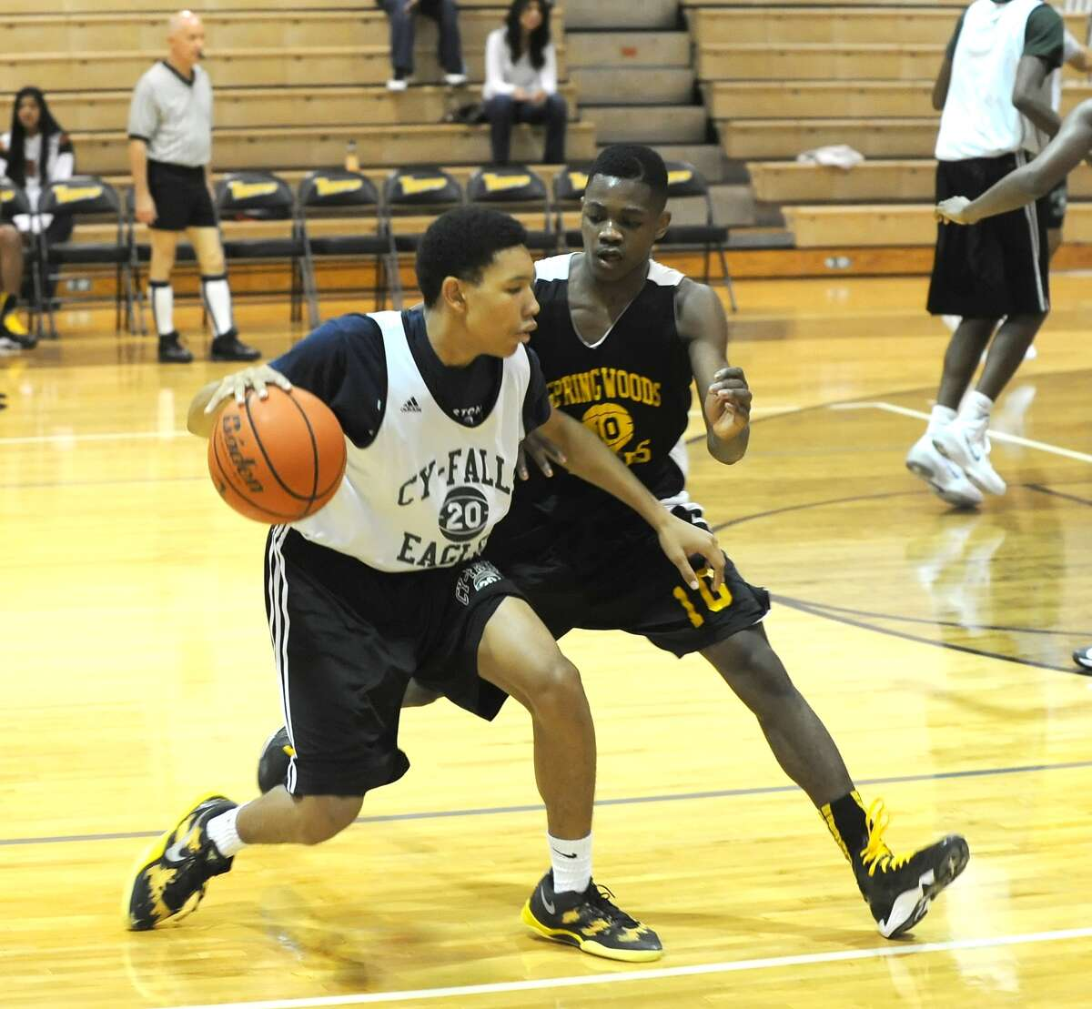 Cy Falls, Spring Woods and Summer Creek participated in a three team scrimmage at Spring Woods High School, 11-9-13. Left, Cy Falls guard Desaun Green (20) can't get around the defense of Spring Woods Jamond Burleson (10).