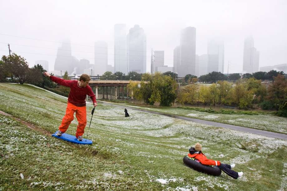 10. Houston Area, including Lake Conroe and Lake LivingstonIn this photo, Chris Lewis of Houston, left, rides a boogie board turned snow sled down a snow slicked hill with Lauren Lewis of Houston, Friday, Dec. 4, 2009, at Eleanor Tinsley Park in Houston.