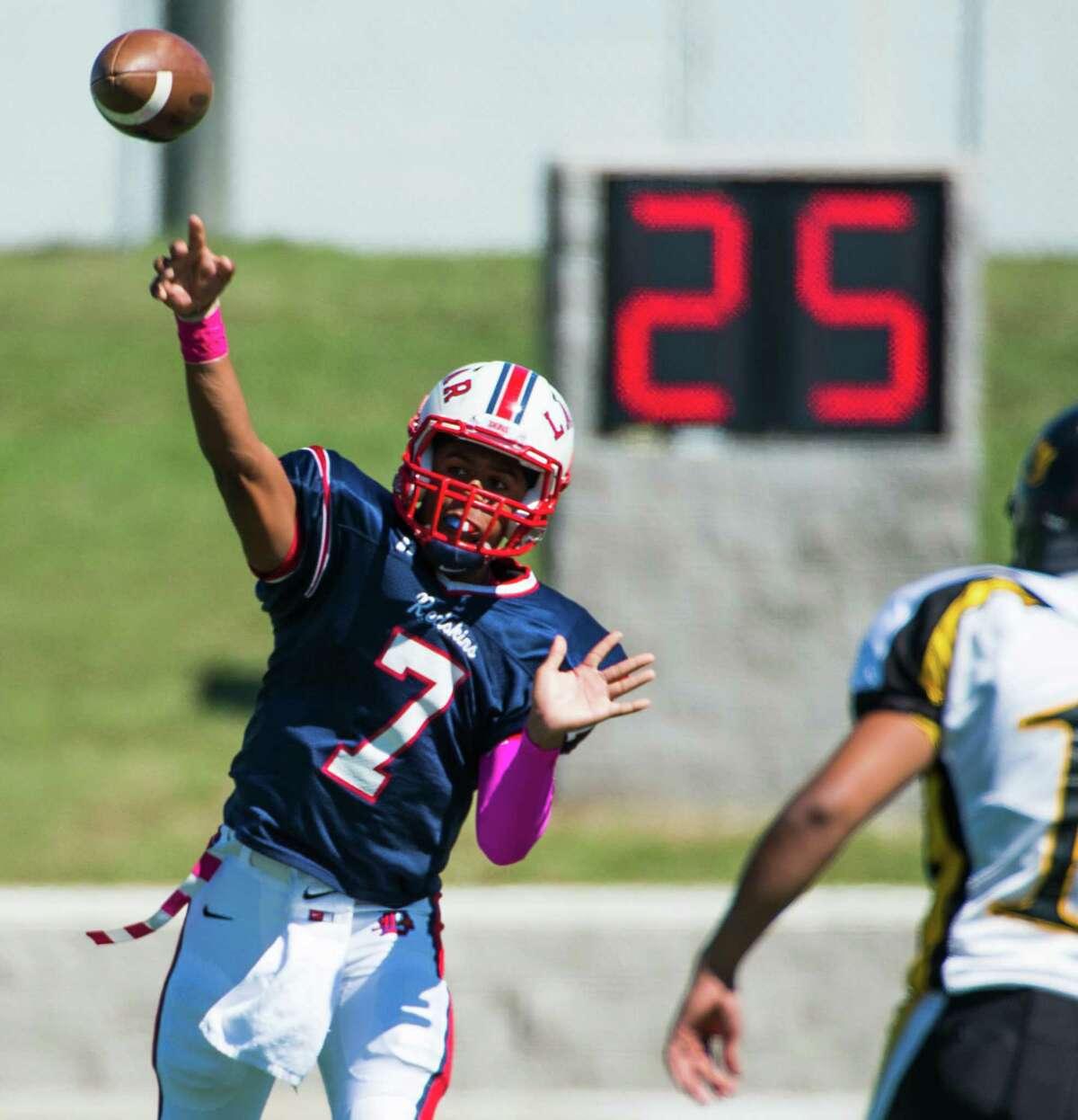 Lamar quarterback Darrell Colbert throws a pass during a high school football against Sam Houston at Delmar Stadium on Saturday, Oct. 19, 2013, in Houston. ( Smiley N. Pool / Houston Chronicle )
